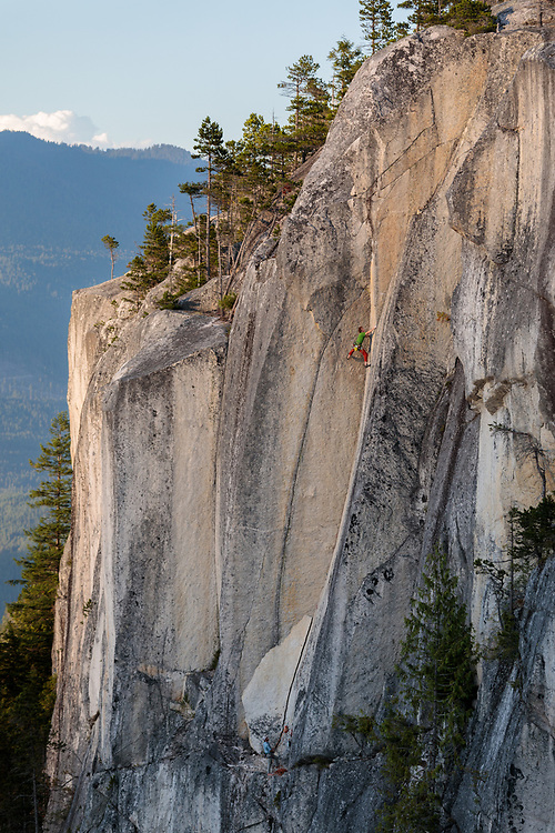 Quentin Roberts climbing North Star, 5.13b at the top of the Chief in Squamish, BC