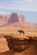 Navajo horseman overlooks Monument Valley.Monument Valley, Utah-Arizona..