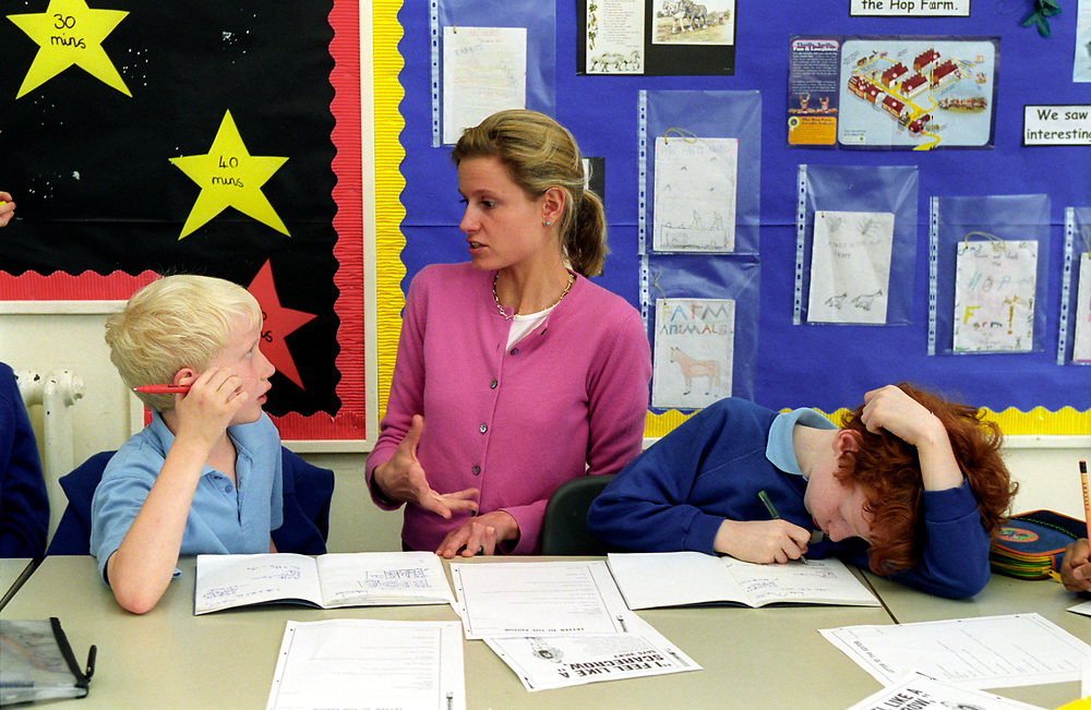 Classroom assistant with pupils,