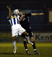 Photo: Chris Ratcliffe.<br /> Colchester United v Swansea City. LDV Vans Trophy. 14/03/2006.<br /> Neil Danns (L) of Colchester tussles with Sam Ricketts of Swansea