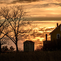 Sunset at Canterbury Shaker Village over the Sisters Shop.