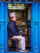 13 MARCH 2017 - PATAN, NEPAL: A man waits for customers in his shop in Patan's Durbar Square.     PHOTO BY JACK KURTZ