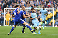 David Silva of Man city is tackled by Chelsea's Cesc Fabregas. Barclays premier league match, Manchester city v Chelsea at the Etihad stadium in Manchester,Lancs on Sunday 21st Sept 2014<br /> pic by Andrew Orchard, Andrew Orchard sports photography.