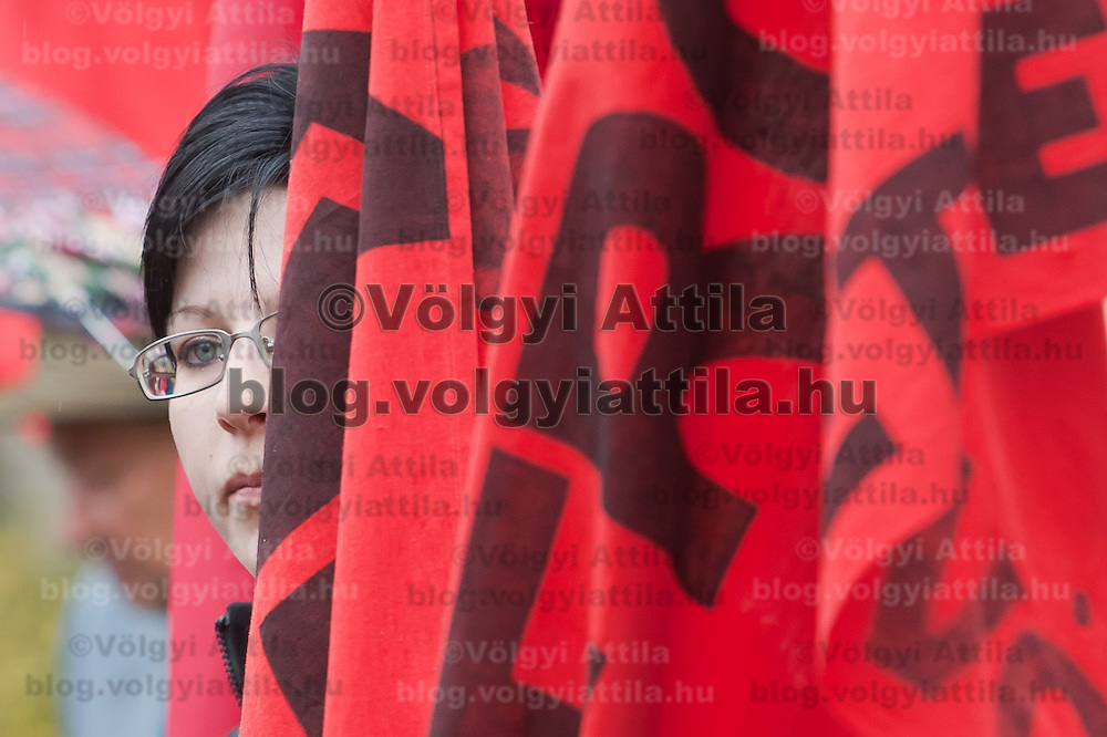 A supporter of the Hungarian Communist Party attends a gathering to march together celebrating Labour Day in Budapest, Hungary on May 01, 2011. ATTILA VOLGYI