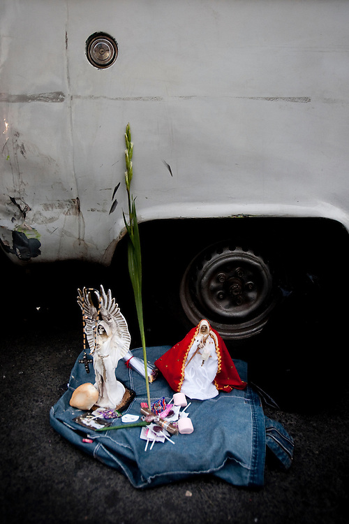 Two small statues of Sante Muerte outside of the Tipito Shrine in Mexico City.