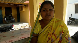 April 27, 2017 - UTTAR PRADESH, INDIA - UTTAR PRADESH, INDIA- APRIL, 24, 2017: Savitri Prajapati, 35, pictured sitting outside police station in Uttar Pradesh, India.....Savitri Prajapati is seen slapping, kicking and hitting Panchu Prajapati with stick and spade. One of her neighbours, who had been noticing her cruel behaviour for more than a year, secretly recorded the video and posted it online. Savitri after interrogation claims to be possessed by a spirit that forces her to beat her father-in-law. She is currently held by the police and charges have been filed against her.....Pictures supplied by: Cover Asia Press (Credit Image: © Cover Asia Press/Cover Asia via ZUMA Press)