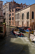 Boat traffic on a canal in Venice, Italy