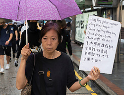 Hong Kong, China. 12th October 2019. Peaceful Pro-democracy march from tourist district of Tsim Sha Tsui along busy Nathan Road to Sham Shui Po Park in Kowloon. Some minor acts of vandalism to property were recorded but most marchers acted peacefully. Evening saw vigil at shrine at Prince Edward MTR  for protestor who died in police custody.Iain Masterton/Alamy Live News.