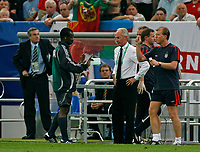 Photo: Glyn Thomas.<br />England v Portugal. Quarter Finals, FIFA World Cup 2006. 01/07/2006.<br /> England's manager Sven Goran Eriksson (C) and assistant Steve McClaren (R) are told to calm down by fourth official Coffi Codjia (second from L).