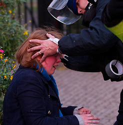 FILE PICTURE - Roundup of yesterdays Student protests..© under license to London News Pictures. 9/12/2010. A young woman is helped by a police medic. On the day that MPs vote on tuition fees, 1000s demonstrated in London against a proposed rise in fees and cuts in support.