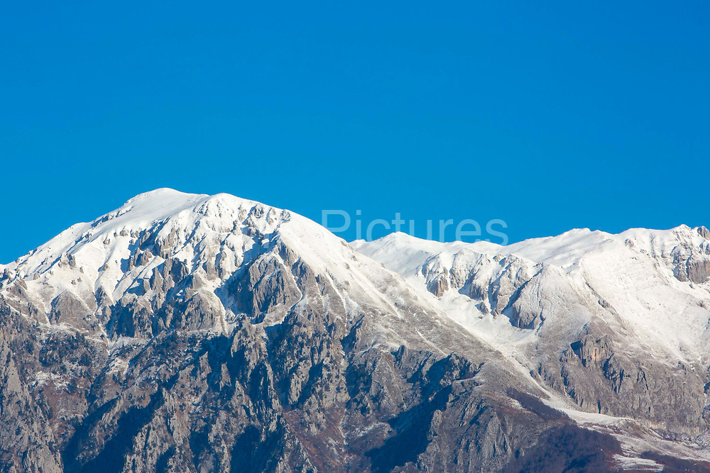 Snow on the mountain tops of Valbona Valley National Park on the 12th of December 2018, high above the town of Bajram Curri, Albania. Bajram Curri is a town located in northern Albania, very close to the border with Kosovo, in a remote, mostly mountainous region.