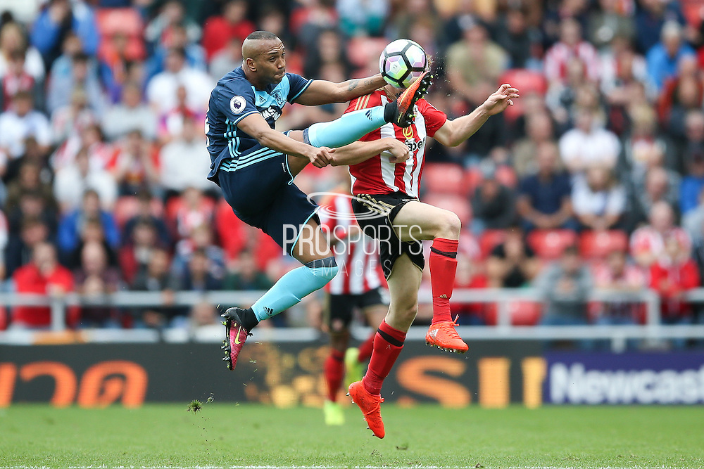 Middlesbrough midfielder Emilio Nsue (24) clears the ball above Sunderland forward Duncan Watmore (14)  during the Premier League match between Sunderland and Middlesbrough at the Stadium Of Light, Sunderland, England on 21 August 2016. Photo by Simon Davies.
