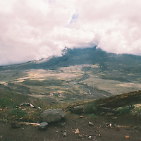 1. When was this photo taken?<br /> <br /> 1982, early fall<br /> <br /> 2. Where was this photo taken?<br /> <br /> Mt. St. Helens<br /> <br /> 3. Who took this photo?<br /> <br /> me<br /> <br /> 4. What are we looking at here?<br /> <br /> Two years after the eruption of Mt. St. Helens the landscape seemed frozen in time; it was eery how little had changed since the ash settled. I think the mud is runoff from Spirit Lake - although it might actually be all that remained.<br /> <br /> 5. How does this old photo make you feel?<br /> <br /> Thrilled to find a surprisingly well preserved record from that time in my life, heartbroken that I don't remember it better, and devastated my papa isn't alive to see these pictures.<br /> <br /> 6. Is this what you expected to see?<br /> <br /> Every once in a while I've wondered what happened to this, my first ever roll of 35mm. Definitely wouldn't have predicted I'd find it 35 years later, still in the canister, tumbling around in a (lead x-ray proof!) bag of unexposed Kodachrome.<br /> <br /> 7. What kind of memories does this photo bring back?<br /> <br /> Papa bought this camera for me: a Pentax Super Program, which was not only my first 35mm, but sounded very, well... super. I was heading off to spend a year in the Philippines a few weeks later, and felt decidedly grown up. <br /> <br /> Later that week we took a steam train up to the recently transformed Mt. St. Helens, mostly just because my pa really loved old trains. Pretty sure I feigned boredom - the significance of the landscape was lost on me - but I was secretly convulsing with pride to be casually wielding a tool so befitting my worldly sophistication. I remember thinking Papa was equally proud of me. <br /> <br /> In retrospect, he probably was.<br /> <br /> 8. How do you think others will respond to this photo?<br /> <br /> Guess I leaned towards the dark side of things early on. The view was no doubt achingly beautiful in the other direction. <br /> <br /> An