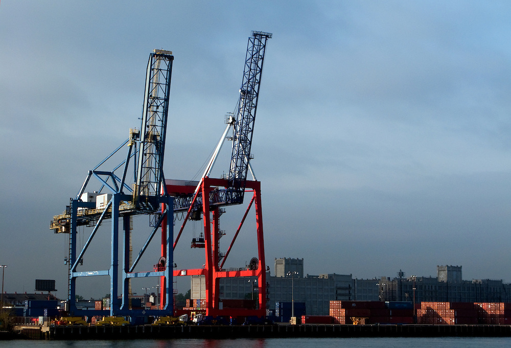 A container crane (also container handling gantry crane, ship-to-shore crane ) is a design of large dockside gantry cranes found at container terminals for loading and unloading intermodal containers from container ships.  These are located in Brooklyn NY