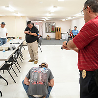 Det. Victor Rodriguez, right, and Sgt. Anthony Seciwa, center, participate in reality based training called Response to Resistance, Wednesday, August 28 by the Gallup Police Department in one of several scenarios the officers participated in.