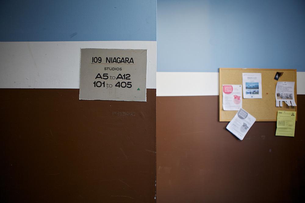 Front entryway signage and bulletin board to 109 Niagara, Toronto.