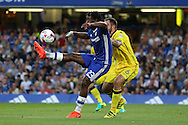 Michy Batshuayi of Chelsea attempts an overhead kick while being marked by Peter Hartley of Bristol Rovers. EFL Cup 2nd round match, Chelsea v Bristol Rovers at Stamford Bridge in London on Tuesday 23rd August 2016.<br /> pic by John Patrick Fletcher, Andrew Orchard sports photography.