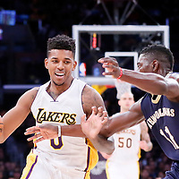 07 December 2014: Los Angeles Lakers forward Nick Young (0) drives past New Orleans Pelicans guard Jrue Holiday (11) during the New Orleans Pelicans 104-87 victory over the Los Angeles Lakers, at the Staples Center, Los Angeles, California, USA.