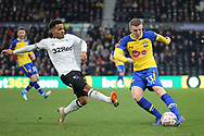 Derby County midfielder Duane Holmes and Southampton defender Matt Targett challenge for the ball during the The FA Cup 3rd round match between Derby County and Southampton at the Pride Park, Derby, England on 5 January 2019.
