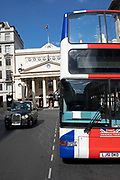 A sightseeing tour bus with the Original Tour Union jack flag branding in London, United Kingdom. Tour buses like this drive all over the capital transporting tourists to see all the sights.