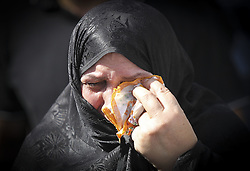 TEHRAN, Oct. 4, 2015 (Xinhua) -- An Iranian woman cries during a funeral ceremony in downtown Tehran, Iran, on Oct. 4, 2015. Thousands of Iranians held ceremonies on Sunday to mourn their pilgrims who died in the latest Hajj stampede in Saudi Arabia on Sept. 24. The ceremonies were held in the capital, Tehran, and Iran's other cities to see off the dead bodies of 104 Iranian pilgrims that were transferred to Tehran on Saturday. . (Xinhua/Ahmad Halabisaz)(cl) (Credit Image: © Ahmad Halabisaz/Xinhua via ZUMA Wire)