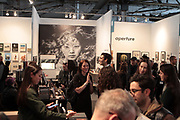 April 8, 2018-New York, New York-United States: Show Attendees attend the Photography Show presented by AIPAD held at Pier 94 on April 8, 2018 in New York City. The Photography Show, held at Pier 94, is the longest-running and foremost exhibition dedicated to the photographic medium, offering contemporary, modern, and 19th century photographs as wells photo-based art, video and new media.(Photo by Terrence Jennings/terrencejennings.com)