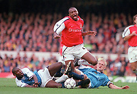 Patrick Vieira (Arsenal) is tripped by Manchester City captain Alf Inge Haaland and Sean Goater. Arsenal v Manchester City, F.A.Carling Premiership, 28/10/2000. Credit Colorsport / Paul Roberts
