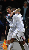 Photo: Paul Greenwood.<br />Bolton Wanderers v Arsenal. The FA Cup. 14/02/2007. Boloton's Gary Speed, left and  Abdoulaye Meiete celebrate