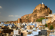 India, Jodhpur. Old part of the town with its blue painted buildings and Forth Mehrangarh.