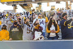 Oct 31, 2020; Morgantown, West Virginia, USA; West Virginia Mountaineers fans celebrate after West Virginia defeated the Kansas State Wildcats at Mountaineer Field at Milan Puskar Stadium. Mandatory Credit: Ben Queen-USA TODAY Sports