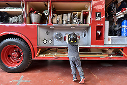 © Licensed to London News Pictures. 09/09/2017. London, UK. A young visitor inspects a Dennis F106 Pump Escape 1968 fire engine on show at London Fire Brigade's annual Fire Engine Festival in Lambeth. The earliest motorised fire engines still working, London Fire Brigade's brand new pump as well firefighter uniforms are on display. Photo credit : Stephen Chung/LNP