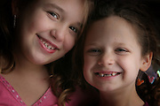 Best friends portrait. Emma Twele and Elli Rose Focht are best friends. Emma lost her teeth.