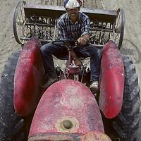 "OWENS VALLEY, CA.  Jay Jensen (MR) plows his alfalfa field at ""Harsh Reality Ranch."""