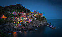 Aerial view of Manarola colorful houses during the night, Italy
