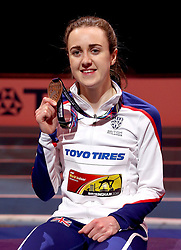 Great Britain's Laura Muir celebrates with her gold medal after the Women's 3000m during day one of the 2018 IAAF Indoor World Championships at The Arena Birmingham, Birmingham.