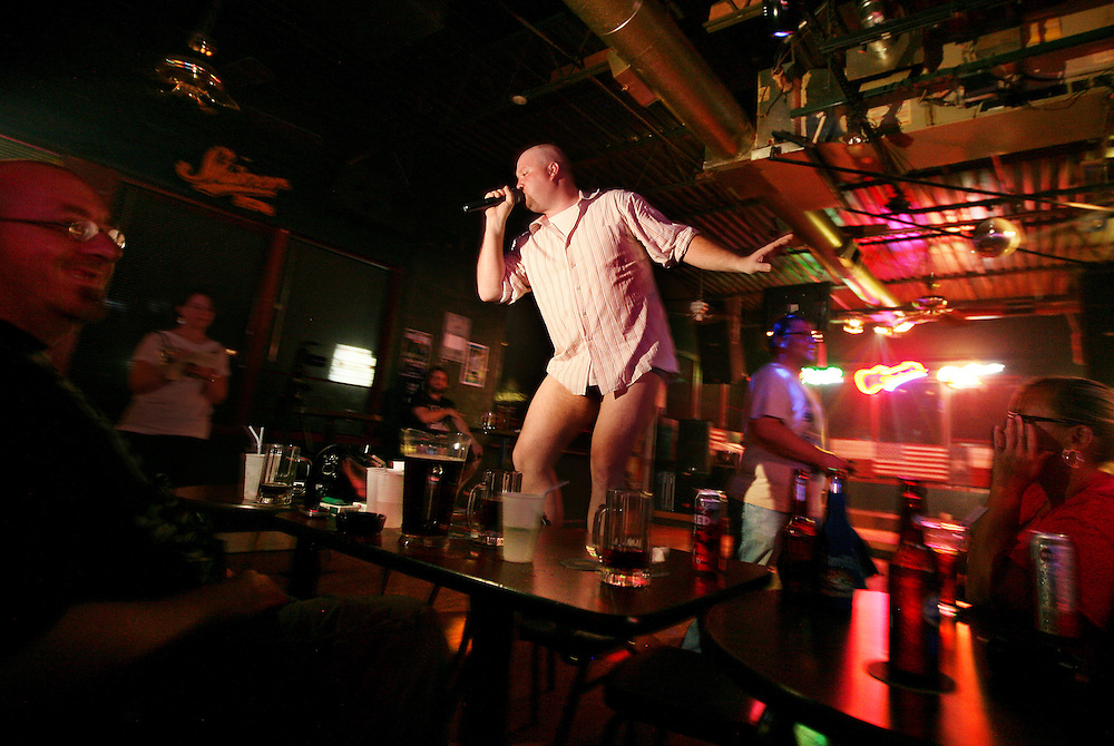 """DJ and karaoke master Richard Underwood sings """"Old Time Rock & Roll"""" at the Crazy Horse Saloon in Denton just after midnight Thursday July 8, 2010. It's quite common for Underwood to sing one song pantless during a show."""