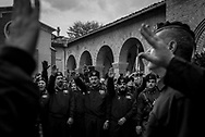 Men in fascit uniforms performing a roman salute outside the crypt where Benito Mussolini is burried.. About 2000 fascists gathered in Predappio, Italy to commemorate the annivrsary of the 'Marcia su Roma' A march held on October 28th 1922 and marked the start of the Italian fascit era .Federico Scoppa