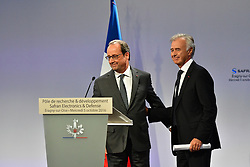 French President Francois Hollande along with Safran Electronics director-general Philippe Petitcolin during the inauguration of the Research and Development Center Safran Electronics and Defense, in Eragny, near Paris, France on October 5, 2016. Safran is an international high-technology group and supplier of systems and equipment in its core markets of Aerospace, Defense and Security. Photo by Christian Liewig/ABACAPRESS.COM