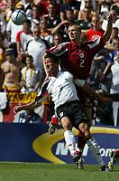 Fotball<br /> Euro 2004<br /> Portugal<br /> 19. juni 2004<br /> Foto: Dppii/Digitalsport<br /> NORWAY ONLY<br /> Tyskland v Latvia 0-0<br /> IGORS STEPANOVS (LAT) / FREDI BOBIC (GER)