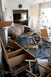 08 Sept 2005.  New Orleans, Louisiana. Hurricane Katrina aftermath. <br /> Venetian Isles in East New Orleans, where the tidal surge washed over the land and devastated homes and property. The Lala families mud filled flood ravaged home.<br /> Photo; ©Charlie Varley/varleypix.com