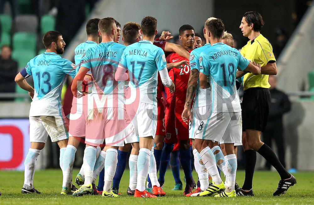 The England and Slovenia players argue between themselves - Mandatory by-line: Robbie Stephenson/JMP - 11/10/2016 - FOOTBALL - RSC Stozice - Ljubljana, England - Slovenia v England - World Cup European Qualifier