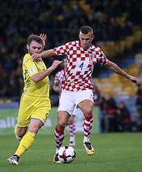 October 9, 2017 - Kiev, Ukraine - Ukraine's Olexandr Karavaev, left, and Croatia's Ivan Perisic, right, in the fight for the ball during the World Cup Group I qualifying soccer match between Ukraine and Croatia at the Olympic Stadium in Kiev. Ukraine, Monday, October 9, 2017  (Credit Image: © Danil Shamkin/NurPhoto via ZUMA Press)