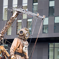 LIVERPOOL, UK, 20th April, 2012. The Sea Odyssey. The giant Uncle walks down the strand passing offices blocks.