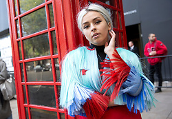 Fashion blogger Charlotte Hole wears a blue hair jacket by Krasimira Stoyneva outside the BFC Show Space Show during the London Fashion Week SS18.