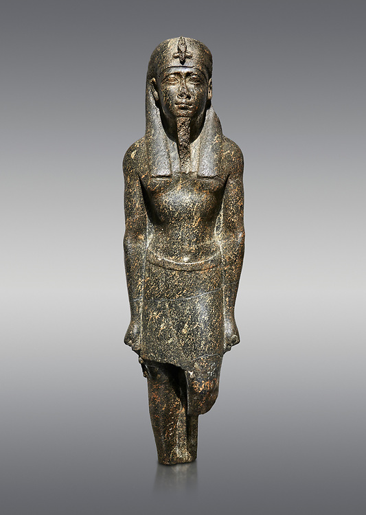 Ancient Egyptian statue of a Ptolomaic king in pharaonic regalia, granodiorire, Ptolemaic Period (332-30BC). Egyptian Museum, Turin. Grey background<br /> <br /> The Ptolomaic king is dressed a a pharaoh wearing a nemes headdress and a false beard . Drovetti Collection, Cat 1384 .<br /> <br /> If you prefer to buy from our ALAMY PHOTO LIBRARY  Collection visit : https://www.alamy.com/portfolio/paul-williams-funkystock/ancient-egyptian-art-artefacts.html  . Type -   Turin   - into the LOWER SEARCH WITHIN GALLERY box. Refine search by adding background colour, subject etc<br /> <br /> Visit our ANCIENT WORLD PHOTO COLLECTIONS for more photos to download or buy as wall art prints https://funkystock.photoshelter.com/gallery-collection/Ancient-World-Art-Antiquities-Historic-Sites-Pictures-Images-of/C00006u26yqSkDOM