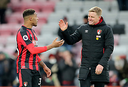 AFC Bournemouth's Jordon Ibe (left) with AFC Bournemouth manager Eddie Howe (right) after the Premier League match at the Vitality Stadium, Bournemouth.