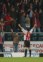Photo: Leigh Quinnell.<br /> Wycombe Wanderers v Cheltenham Town. Coca Cola League 2, Play off Semi Final. 13/05/2006. Cheltenhams Steve Guinan celebrates his goal in front of the traveling fans.