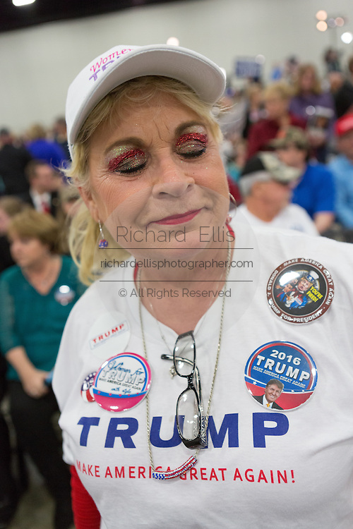 A supporter of Republican presidential candidate billionaire Donald Trump sports patriotic eye make up before the start of a campaign rally at the Myrtle Beach Convention Center November 24, 2015 in Myrtle Beach, South Carolina.