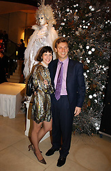 Ballerina DARCEY BUSSELL and her husband MR ANGUS FORBES at a Christmas party to celebrate the 225th Anniversary of Asprey held at their store 167 New Bond Street, London on 7th December 2006.<br /><br />NON EXCLUSIVE - WORLD RIGHTS
