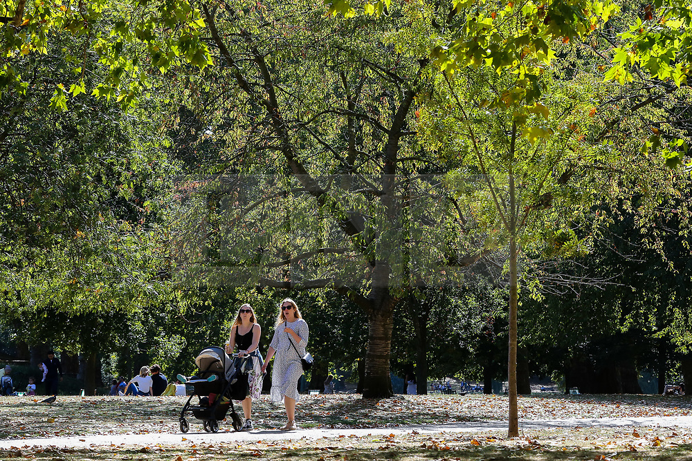 © Licensed to London News Pictures. 13/09/2019. London, UK. Women walking with a pram in St James's Park on a warm and sunny day in the capital. According to the Met Office, the temperature is likely to reach 25 degrees celsius this weekend in many parts of UK. Photo credit: Dinendra Haria/LNP